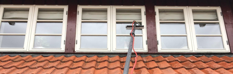 vinduespudsning med vaskeanlæg